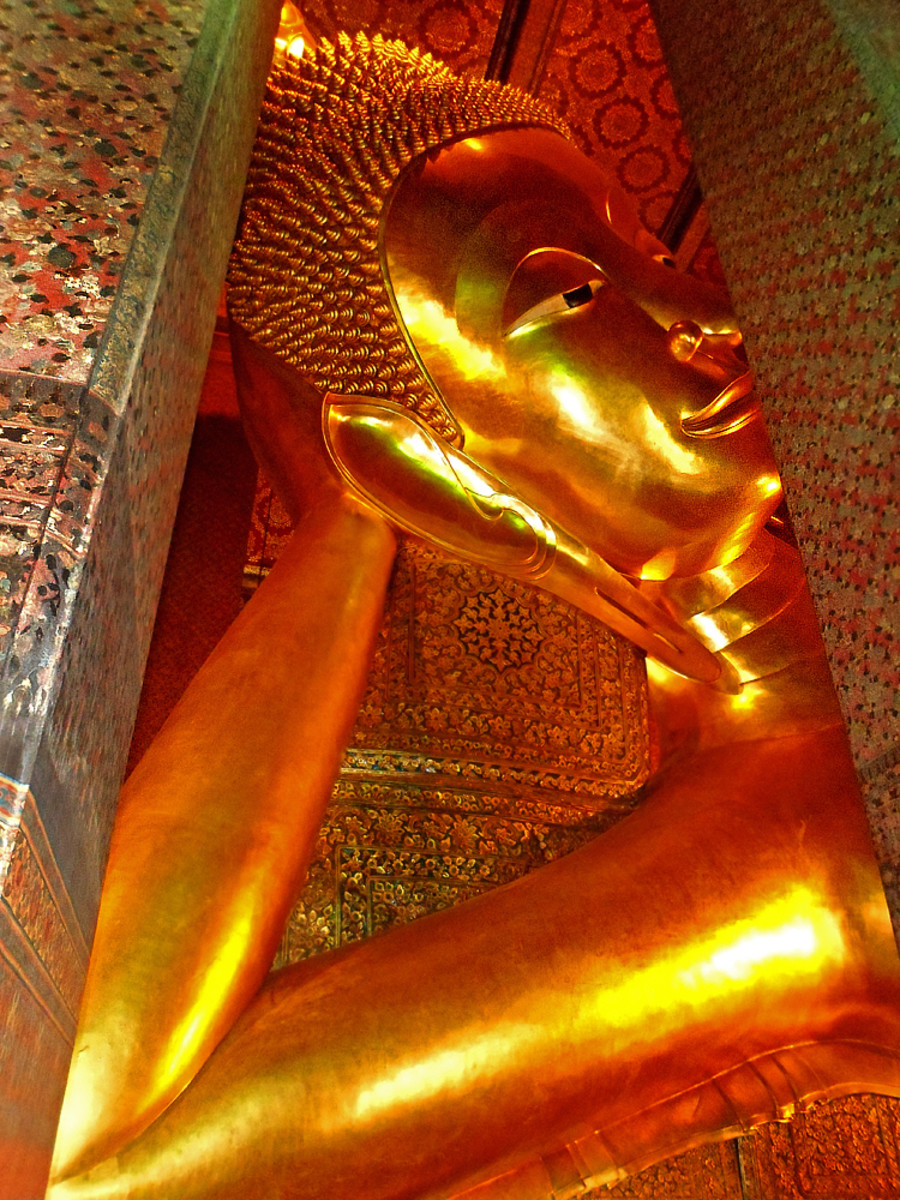 The giant Reclining Buddha at Wat Pho temple complex in Bangkok, Thailand.