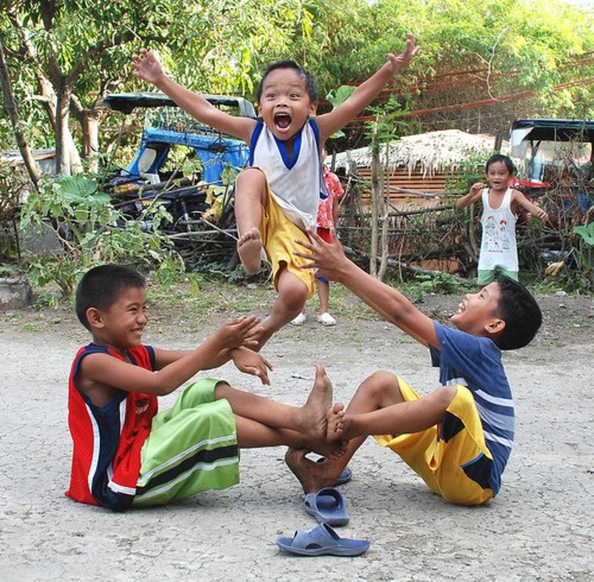 "The ""luksong tinik"" a traditional street jumping game. Picture from filipinolifeinpictures.blogspot.com"