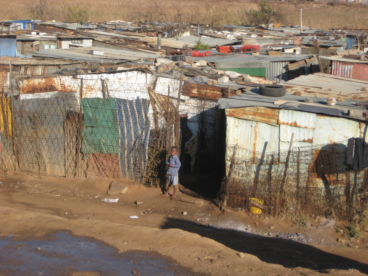 Matchbox houses composed from corrugated metal, scrap wood, cardboard, and sometimes cement similar to these shacks in the Kliptown community south of Johannesburg make up the hundreds of neglected squatter camps and informal settlements that more th
