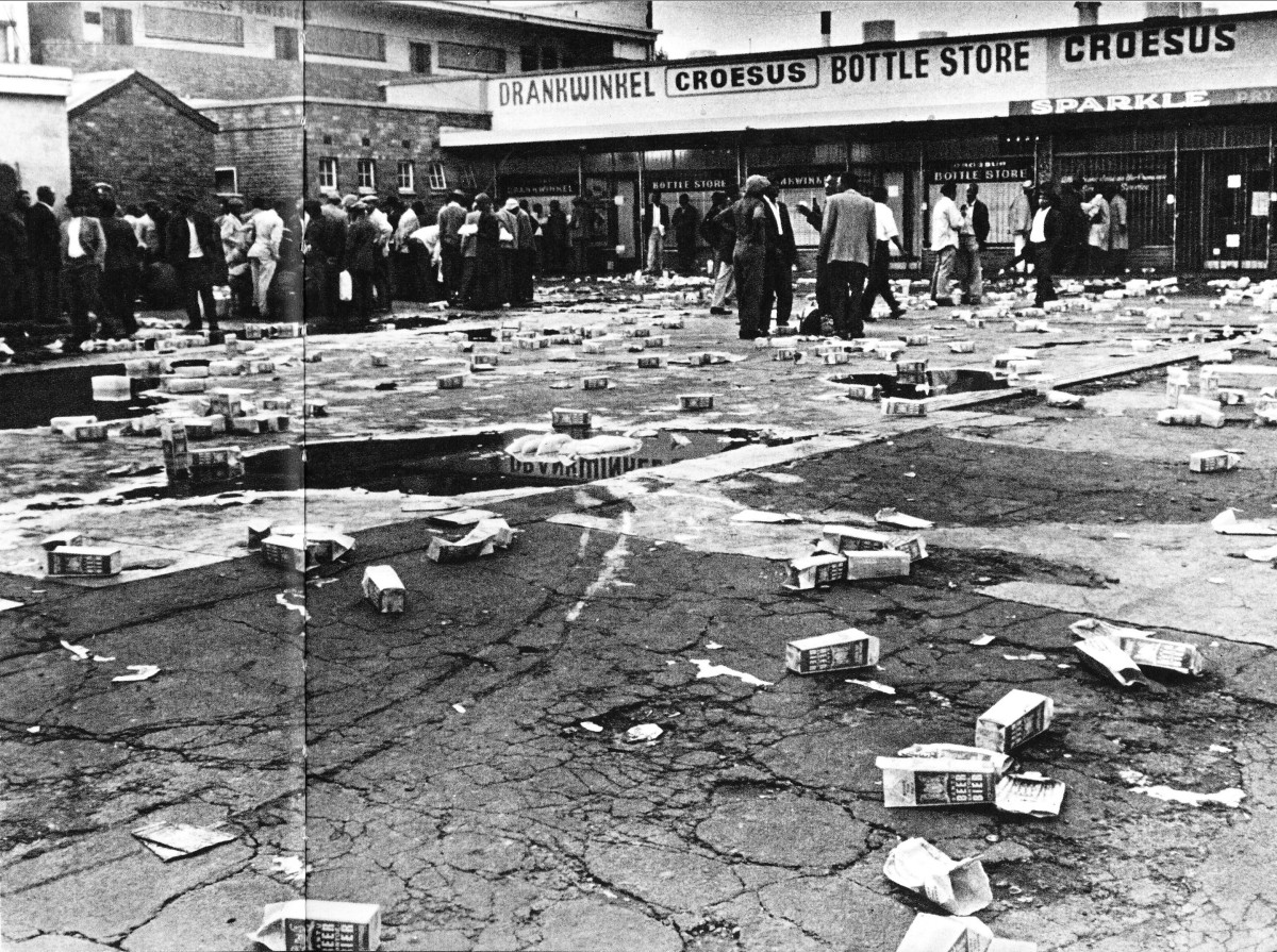 """Cartons of """"Bantu Beer"""" littered all over the grounds where men were drinking it. This was sold by the government and was called """"Bantu Beer"""", and has been poisoned over the decades, not as Botha claims was to be done from 1985, but done from the1950"""