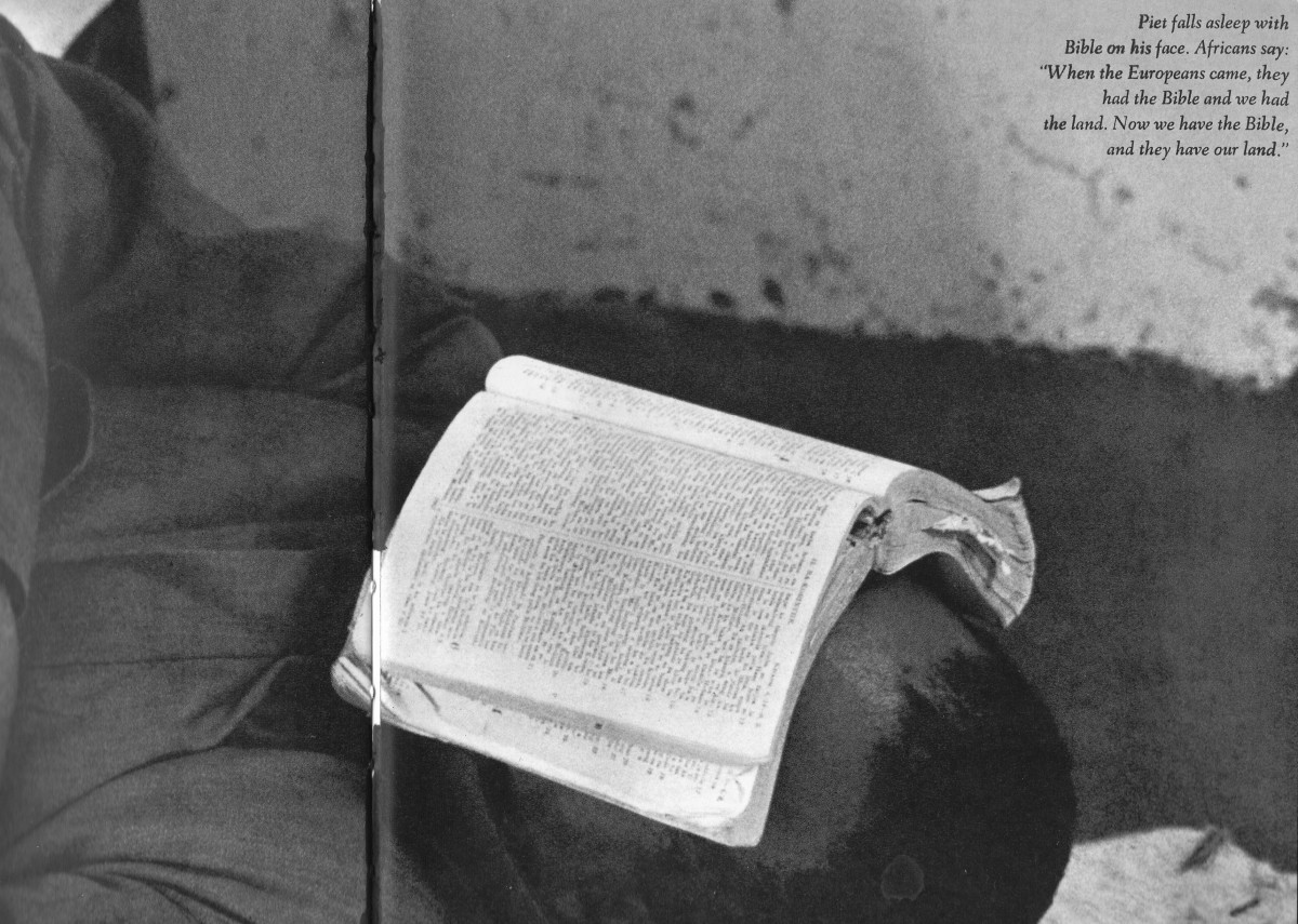 """The caption reads: Piet falls asleep with Bible on his face, Africans say: When the Europeans came, they had the Bible a. Now we have the Bible, and they have our land."""""""