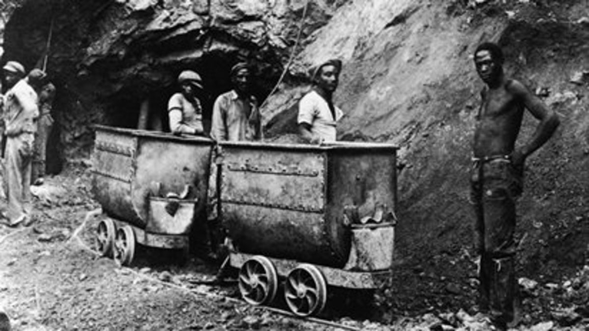 African Miners working in harsh conditions underground