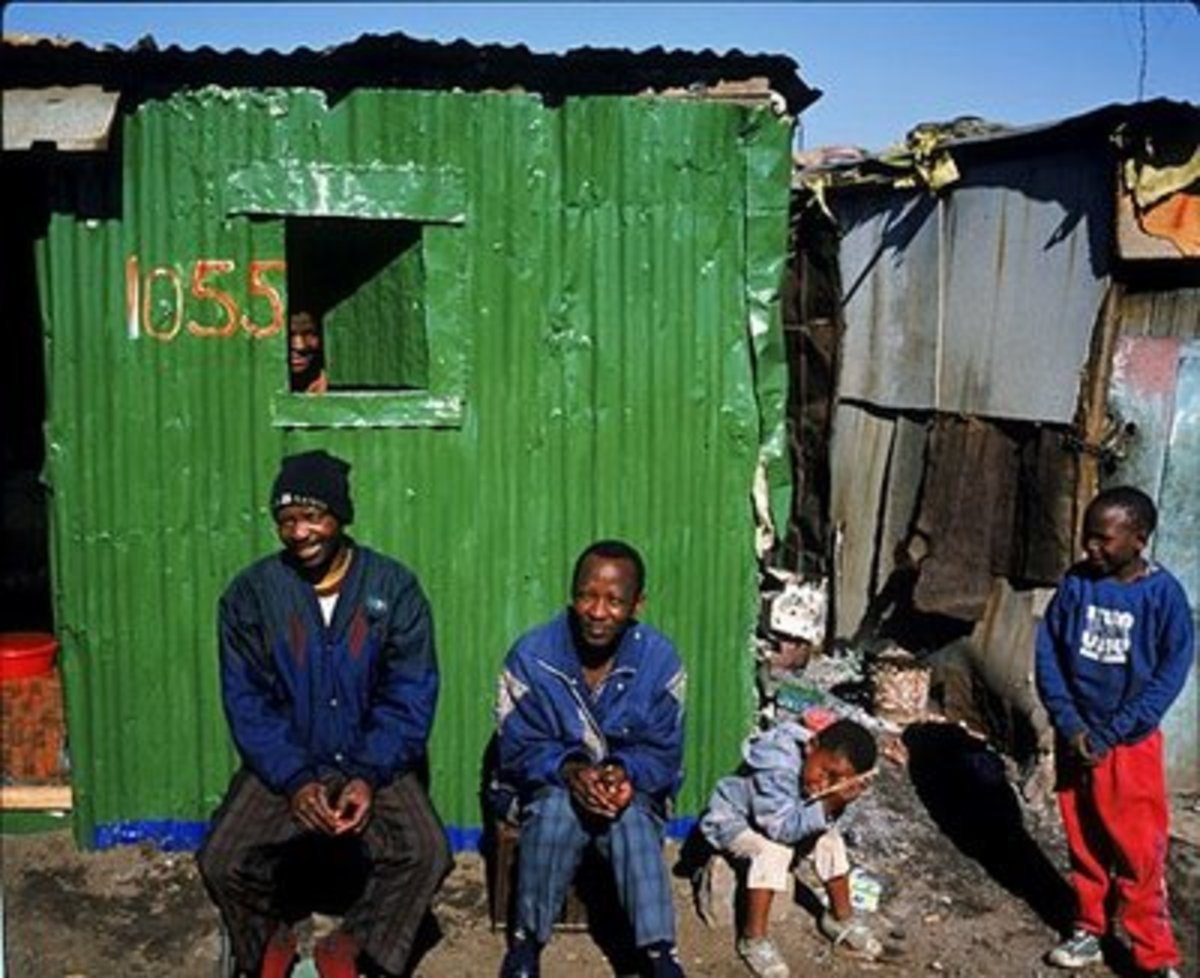 A carry-over of housing from the Apartheid era, still prevalent in today's South Africa. South African democracy was born in Chains.