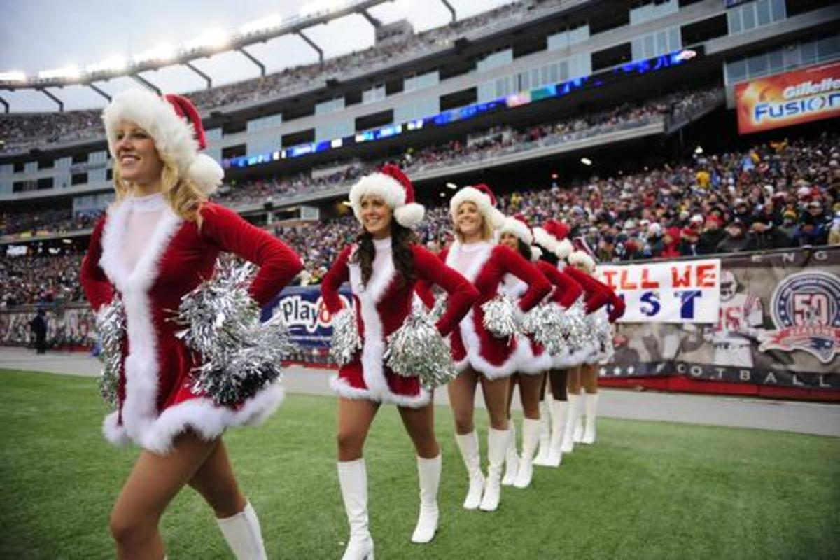 Cheerleaders in red and white with red stocking caps and white boots