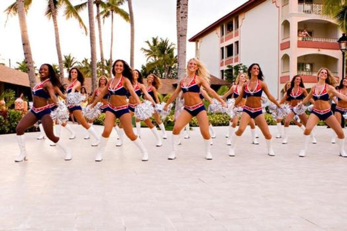 cheerleaders on a white beach