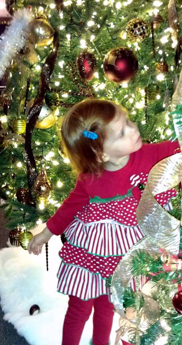 Clara discovering the magic of Christmas.  David, the author of the short story, is her Daddy.