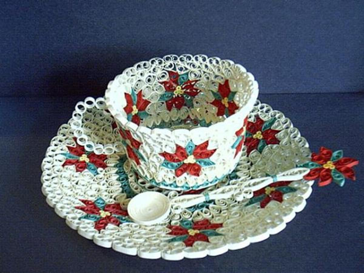 Beautiful 3-D quilled white tea cup, saucer, and spoon