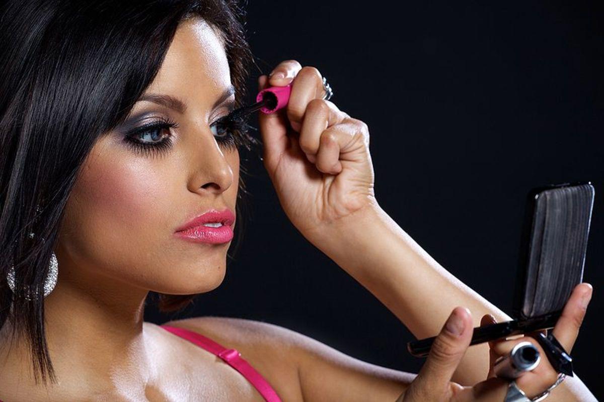 Woman applying make-up.