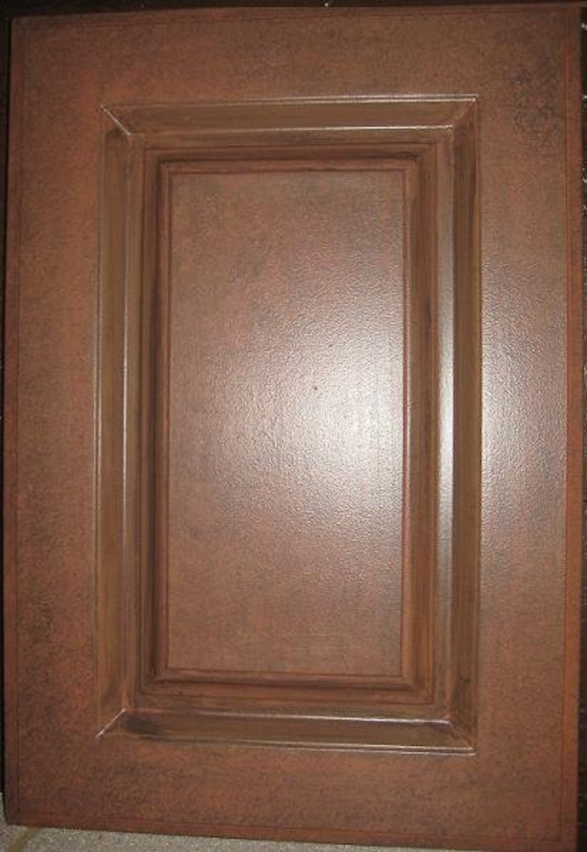 Cabinet door faux painted and glazed to resemble a leather bomber jacket.