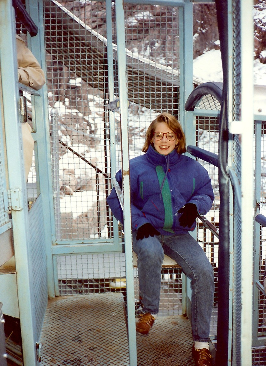 My niece getting seated in her metal cage as we prepare to go down to the Royal Gorge on the Incline Railway.