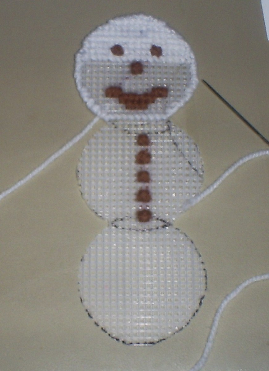 Here the snowman's face is only halfway stitched on.