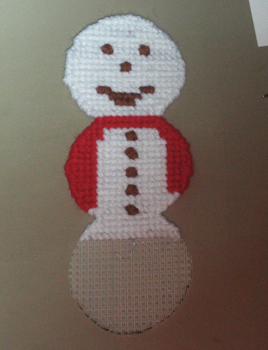Here I am stitching the snowman all the way to the bottom.