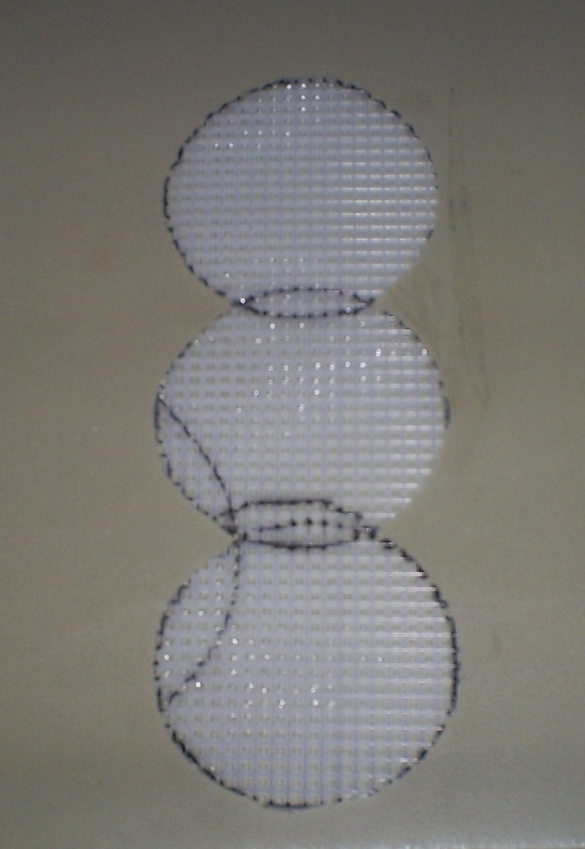 Here I have created a snowman shaped character out of plastic canvas mesh.