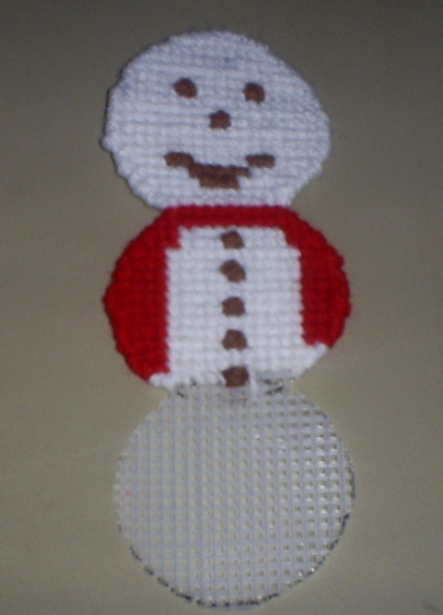 Here I continued stitching on the white yarn.