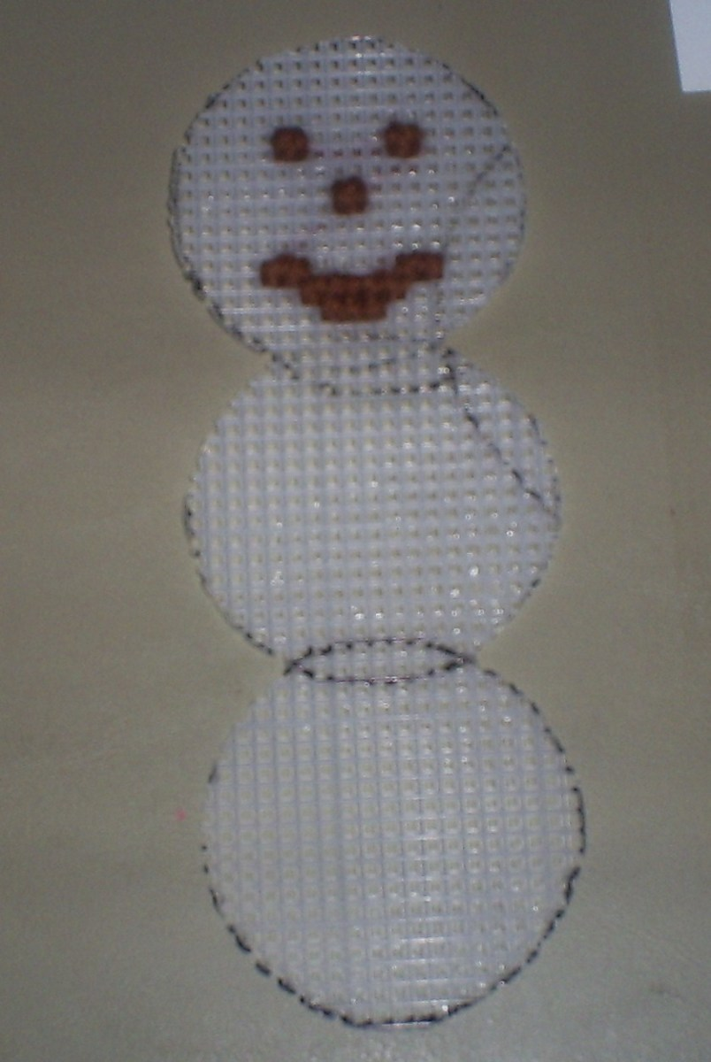 Here I stitched on the snowman's smile.