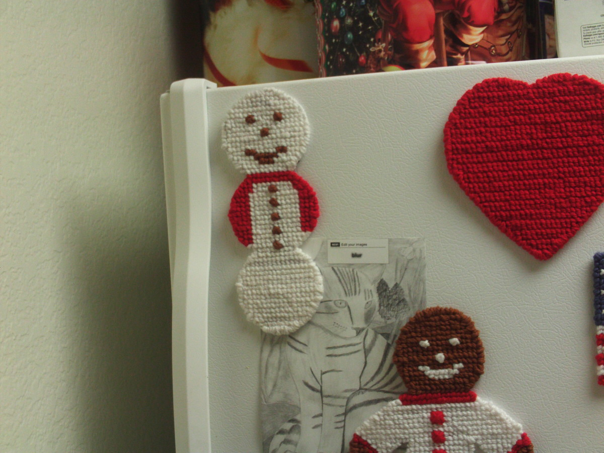 My snowman looks super surrounded by my other cross stitched magnet.  As I said, my cross stitched magnet making is becoming somewhat of an amusing addiction.