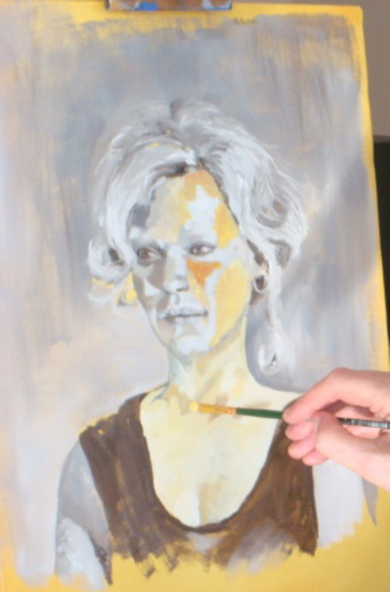 This is an artist in action, painting from a live model.  the canvas has been washed in acrylic paint in Raw Umber and she is painting oil paint in a grey scale, (grisaille) to map out all of her shapes.  When this part is finished, if the model isn'