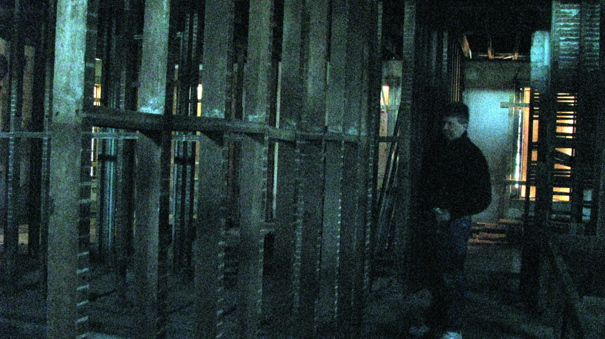 This is a strange photograph.  I did NOT change the color of it in photoshop... all I did was enhance the brightness of it.  The flash in my camera did not go off.  This is Jon standing on the second floor with I believe to be a shadow figure behind