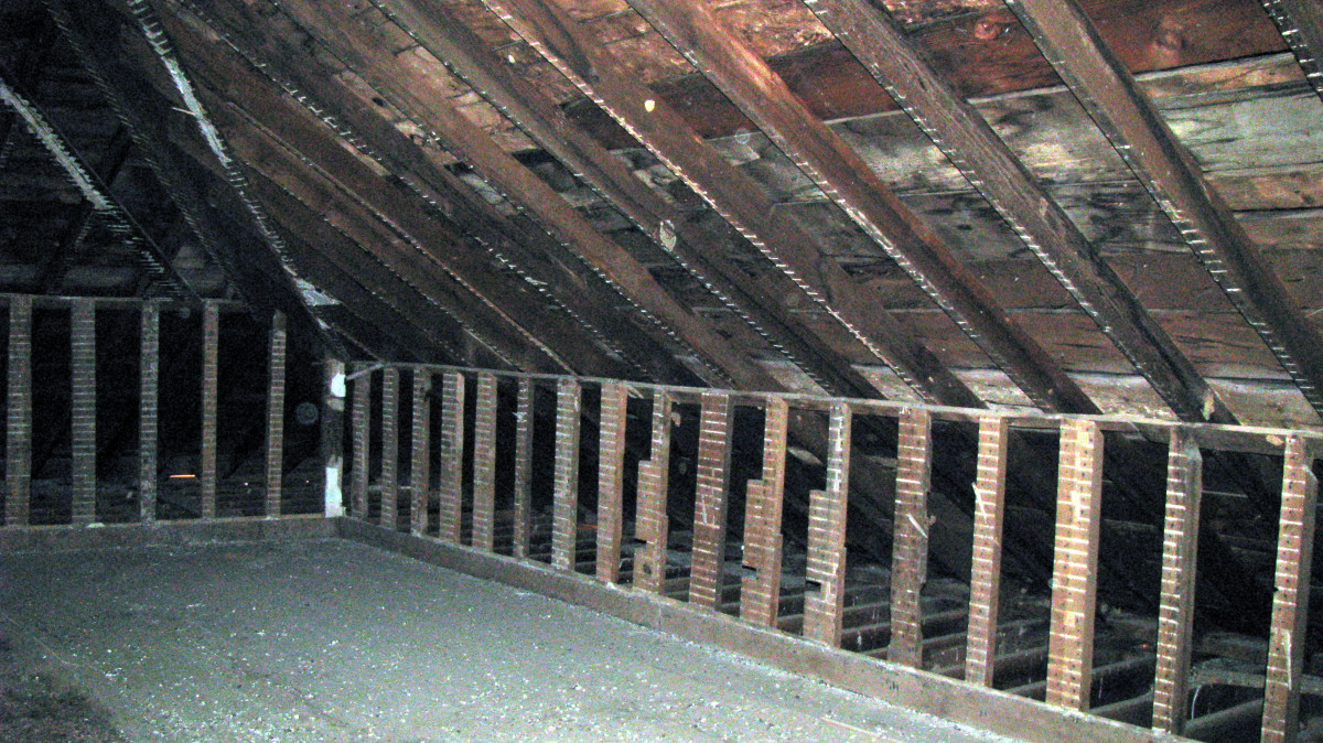 Second photograph taken in the attic.  Two orbs in this one too... This area was located on the right side of where we were standing.  The first was taken straight on from the top of the stairway back into the room.