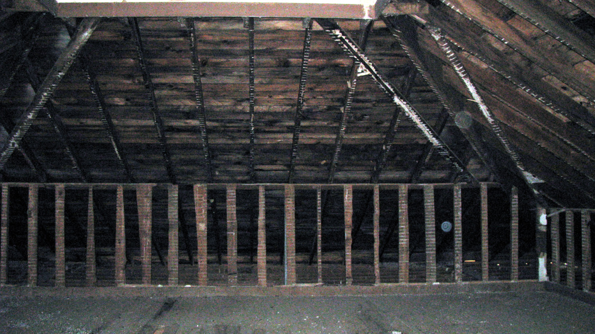Two orbs caught in this photograph... one is between the upright boards and the other is near the ceiling, both to the right.