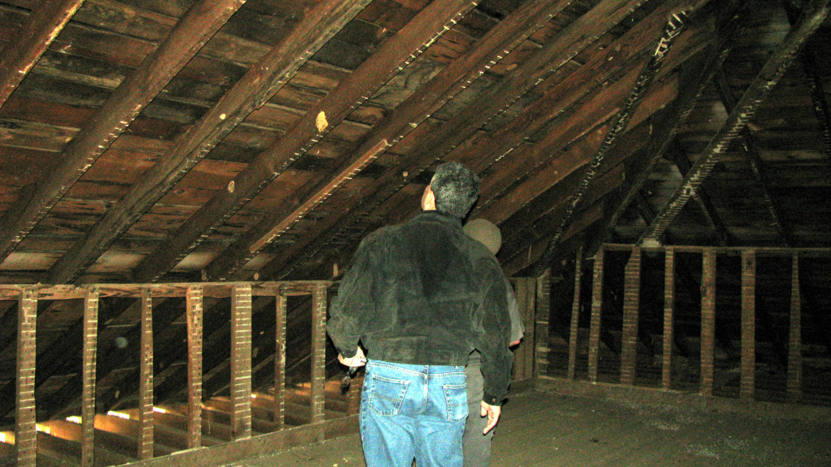 Third photo of John Crane and Jon Almada inspecting the wood used on the roof structure.  It is original!  Orb in this one is also between the lower upright structures.