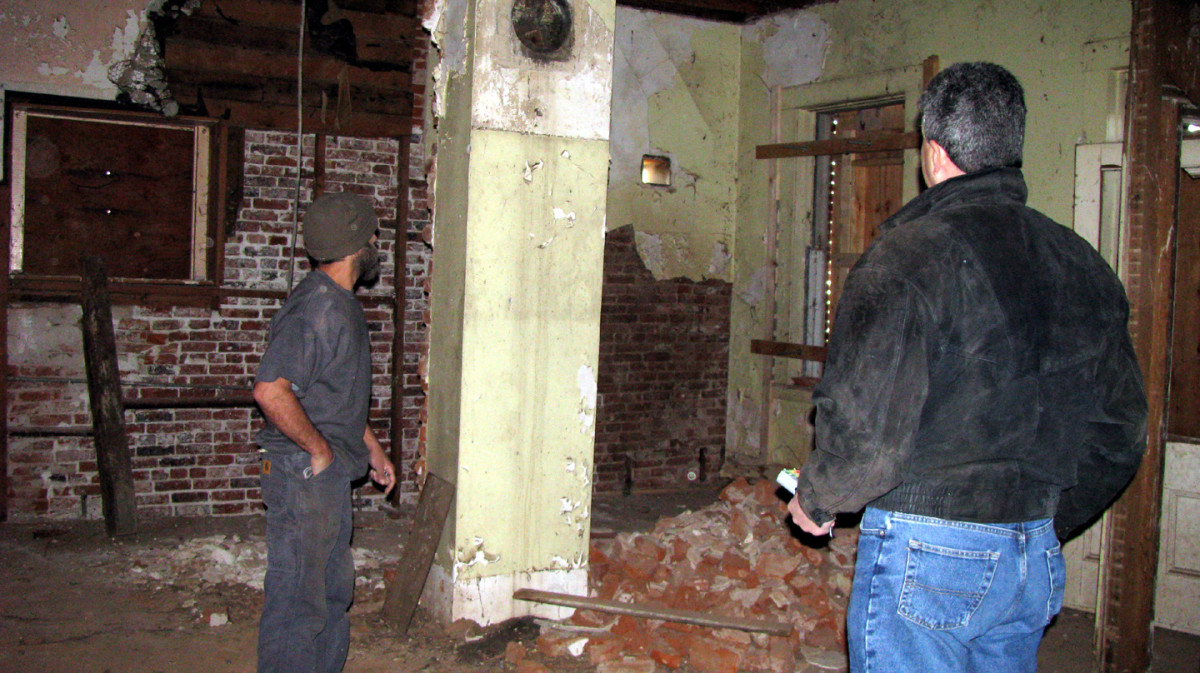 John Crane (left) and John Almada (right) standing in what used to the the kitchen at the back of the house on the first floor.
