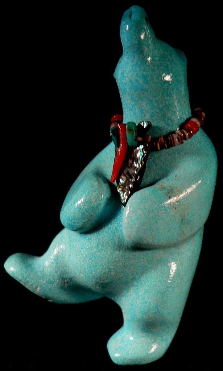 Turquoise dancing bear by Jeffrey Tsalabutie