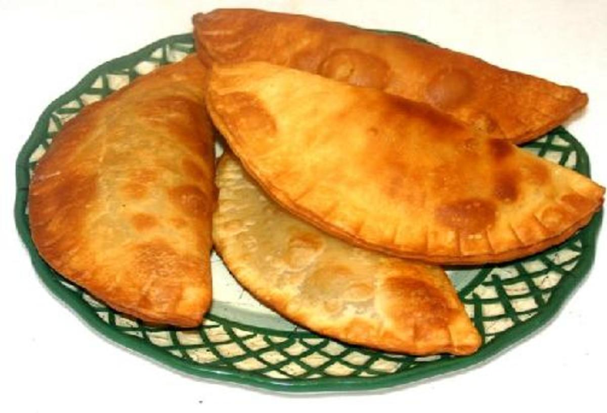 Empanadas can be meat, vegetable, or fruit filled.