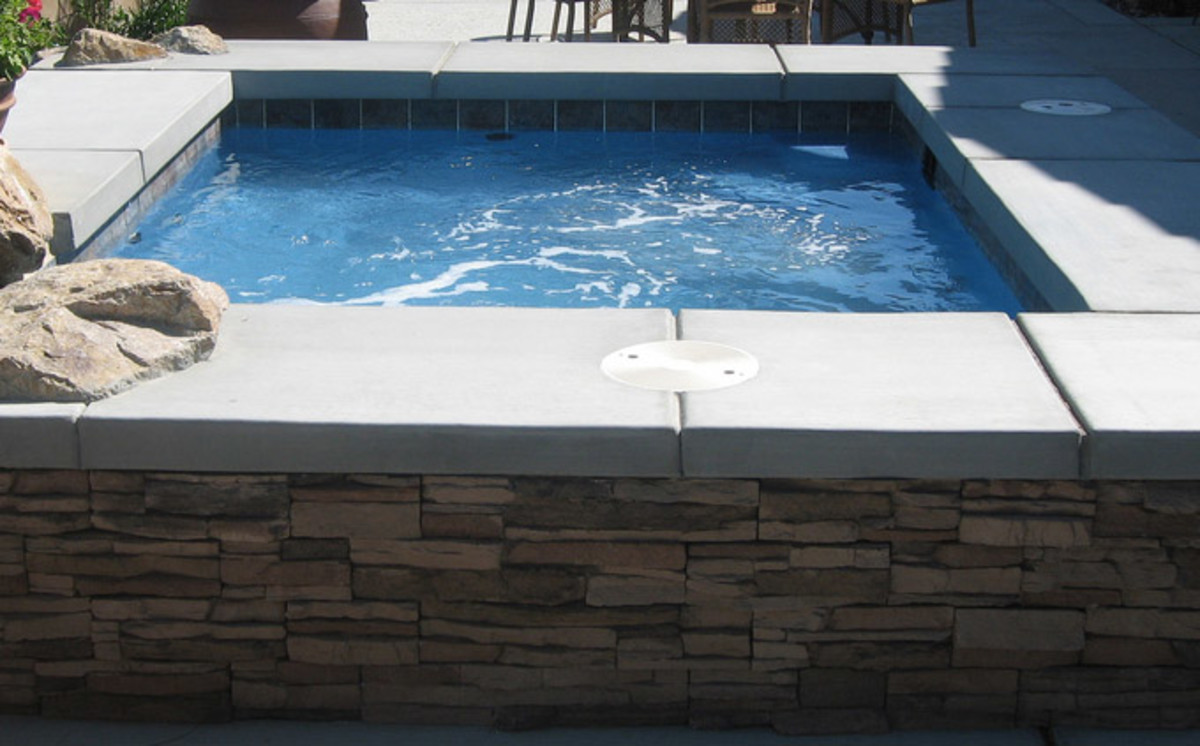 Simple concrete, tile and stone spa.