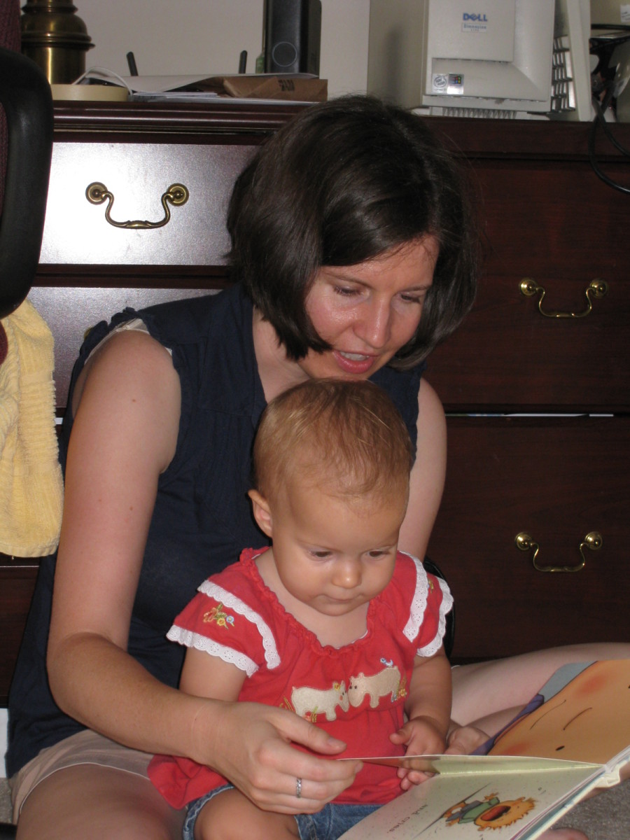 Reading with my little girl.  She's 13 months old in the photo.