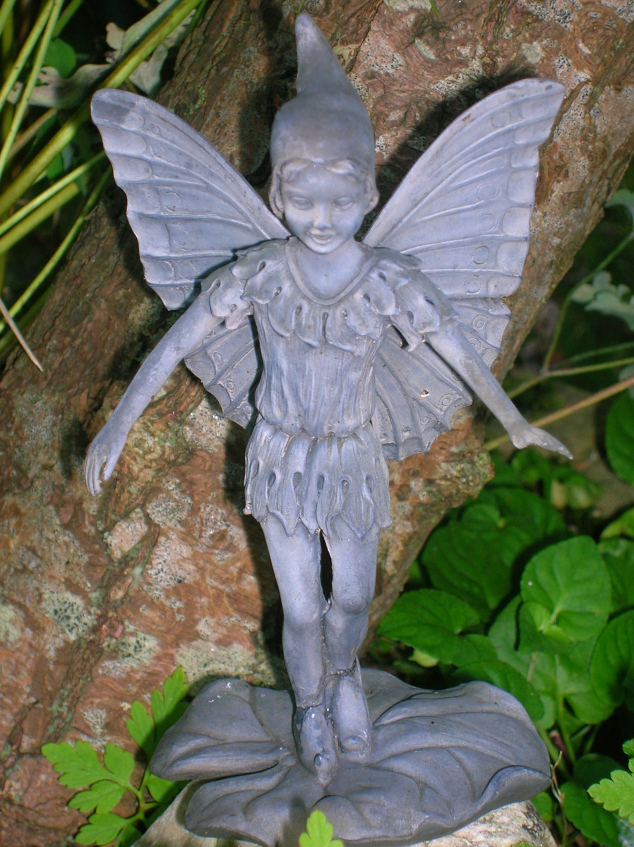 You can include miniature resin fairy statues in your fairy garden, if you want, or leave the inhabitants to the imagination.