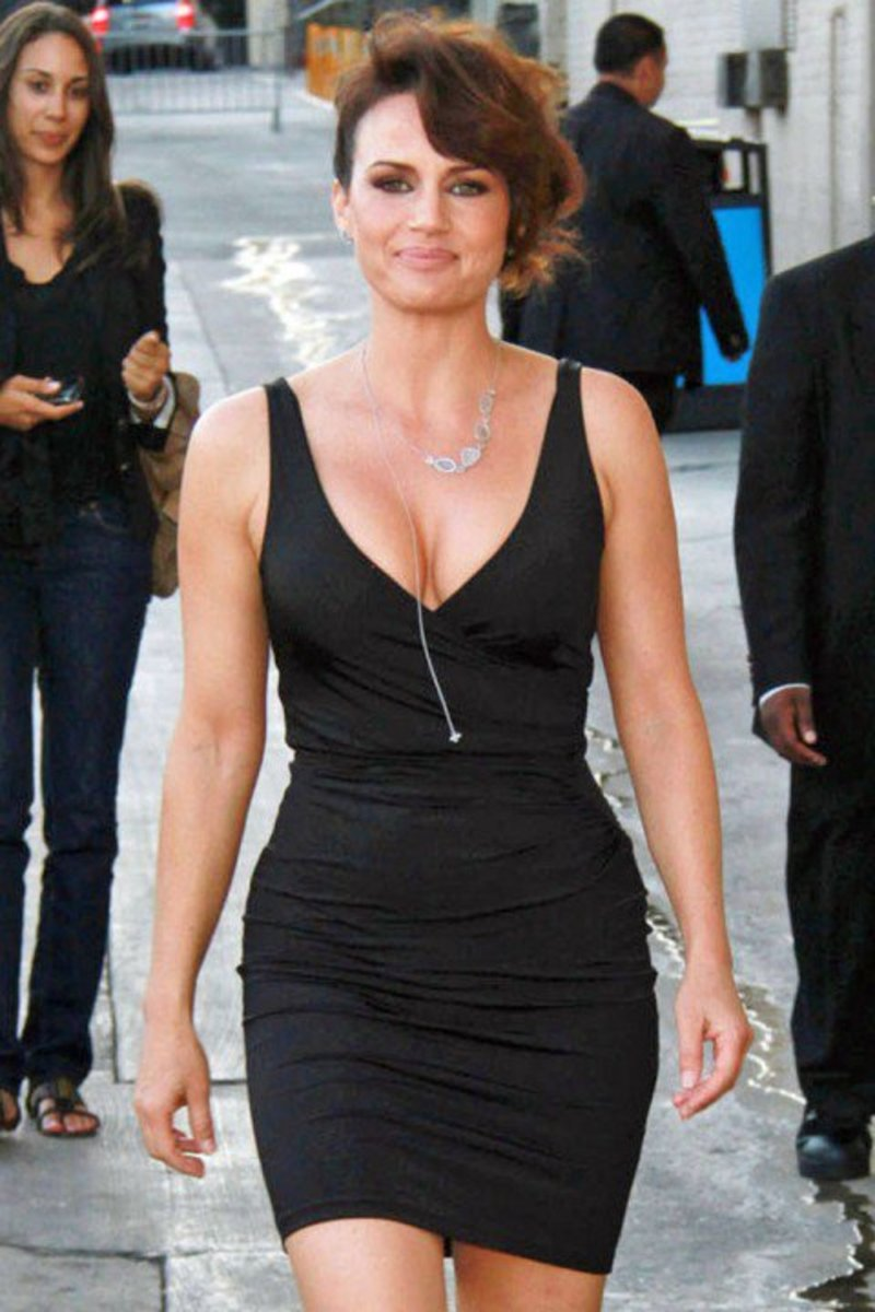 Carla Gugino stunning in a low cut little black mini dress