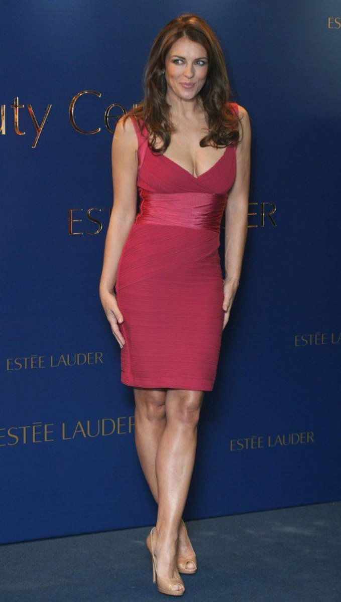 Elizabeth Hurley busty in a lovely little red dress and nude open toe pumps