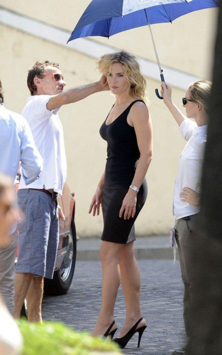 Kate Winslet on set for a commercial in a little black min dress and slingback platform pumps
