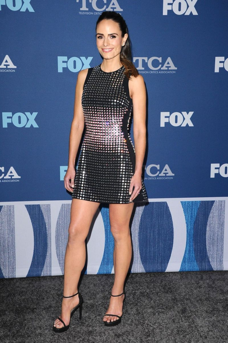 Jordana Brewster in a sexy sequined mini dress and ankle strap stilettos