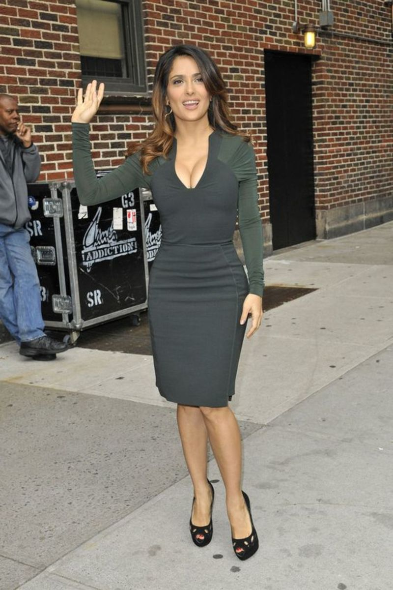 Salma Hayek in a plunging cleavage baring green mini dress and peep toe platform high heels