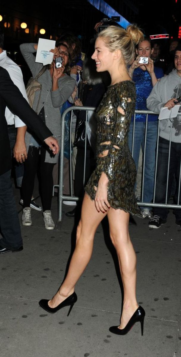 Sienna Miller in a slinky mini dress and black pumps