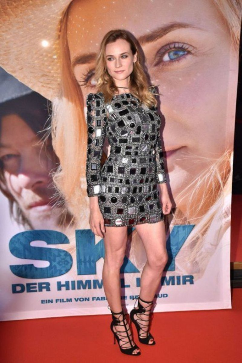 Diane Kruger sexy legs in a checkered black and silver mini dress and black strappy high heels on the red carpet