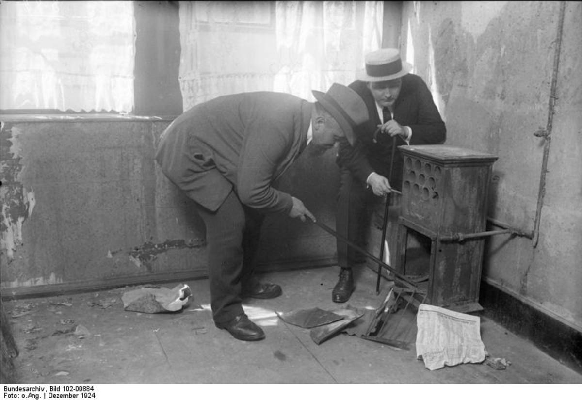 Detectives search a stove inside Fritz Haarmann's apartment