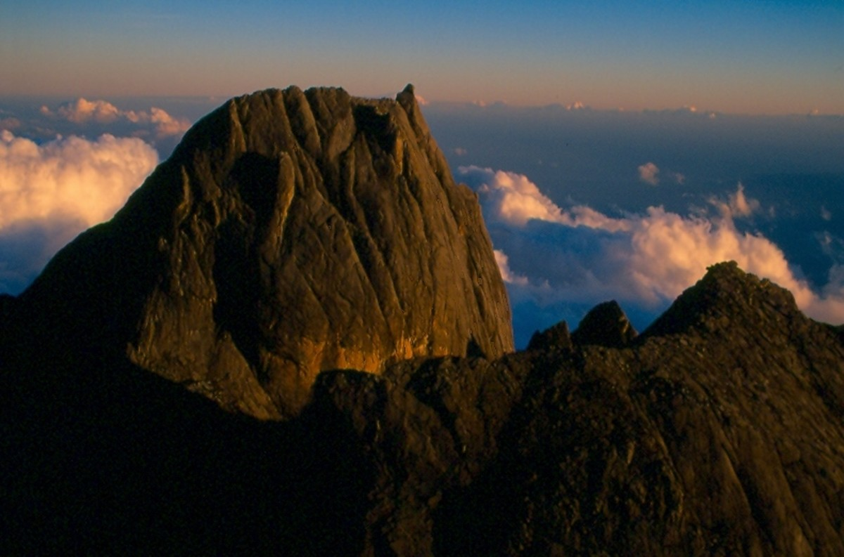 Victoria Peak (13,431') from Lows Peak (13,455') at first light. Gunung Kinabalu National Park, Malaysia.