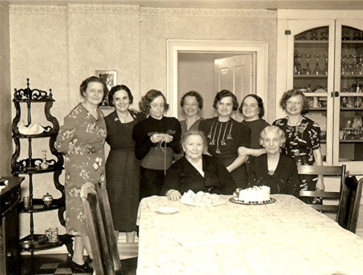 Standing left to right: Alma, my grandmother and others gathered for a birthday party celebration.