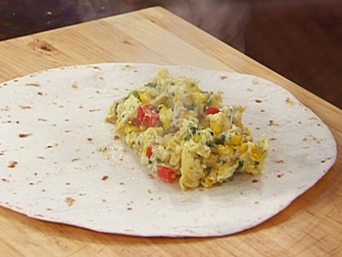 Preparing a homemade breakfast burrito