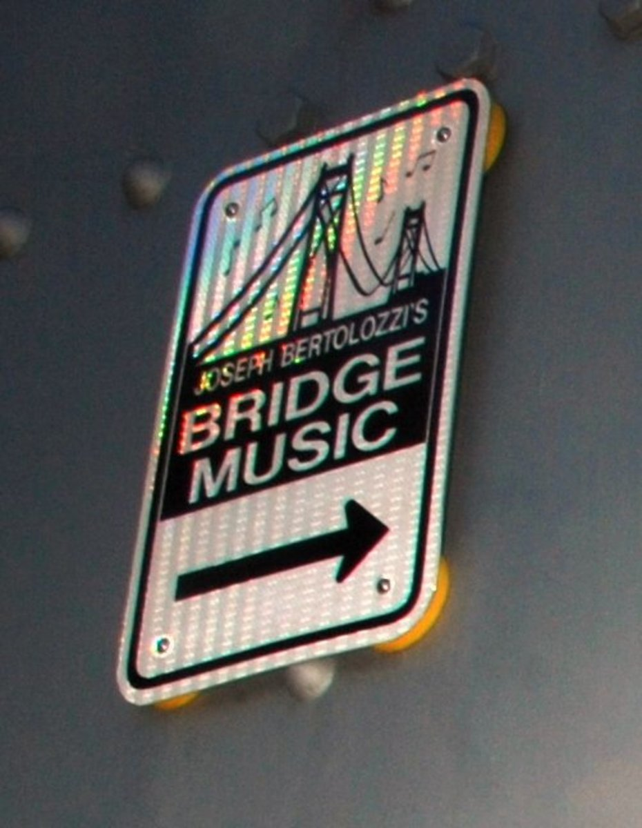 Signs on and near the bridge point out the way to the Bridge Music Listening Stations.