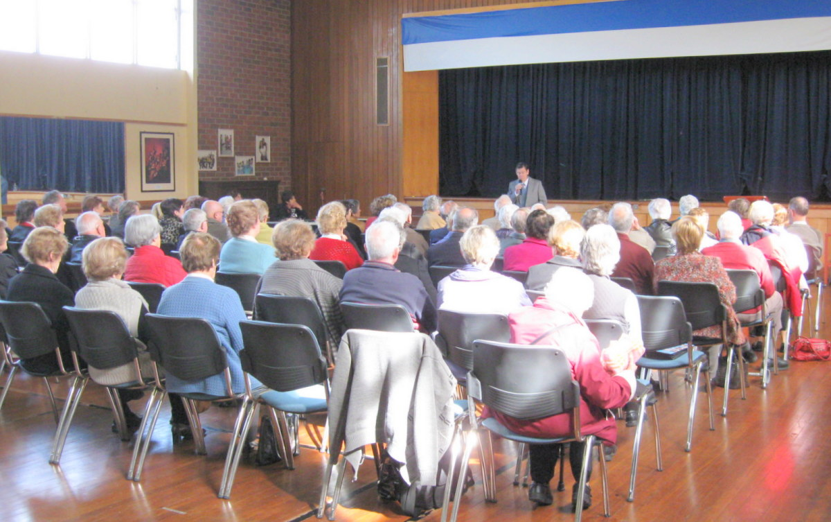 A typical audience of retirees in Australia.  A modern, church hall venue.