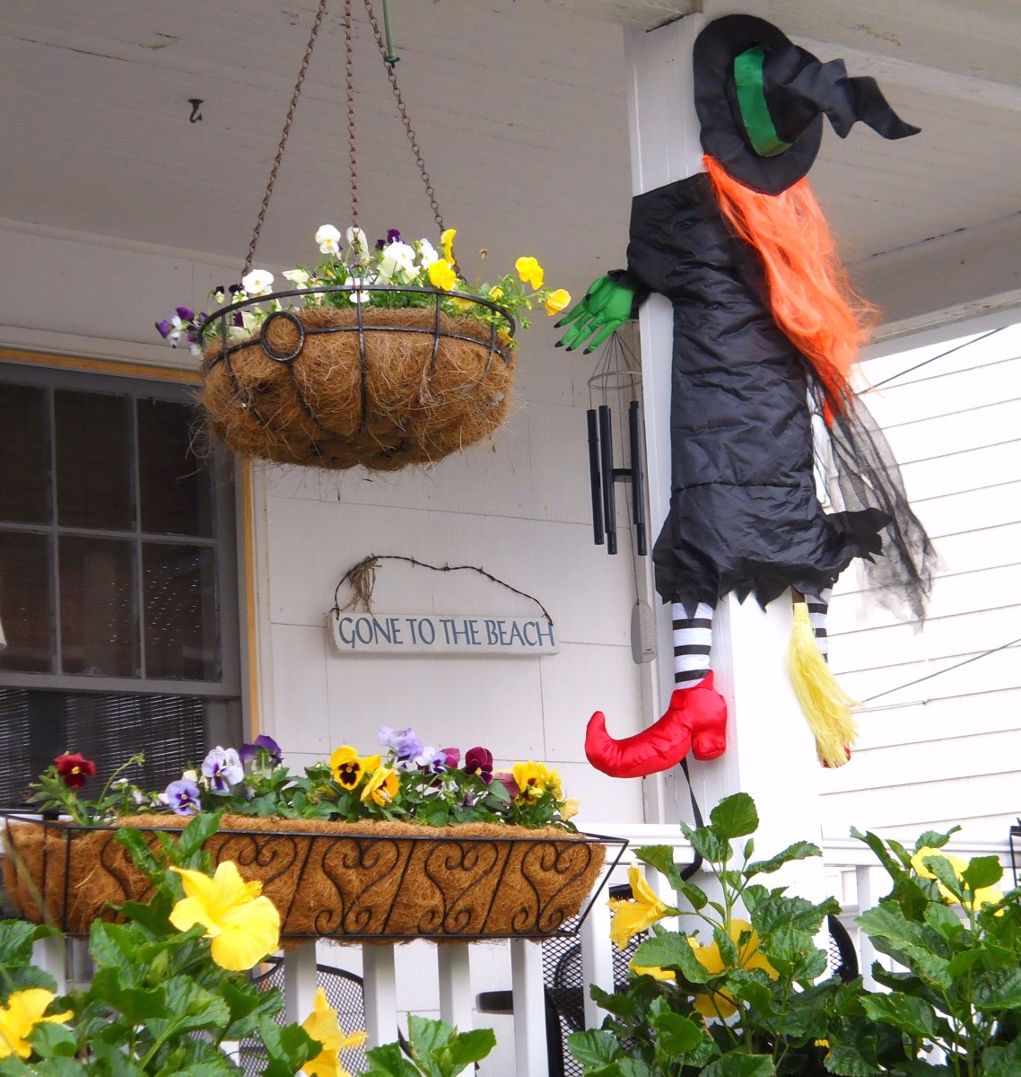 Beach house porch decorated for Sea Witch Festival.