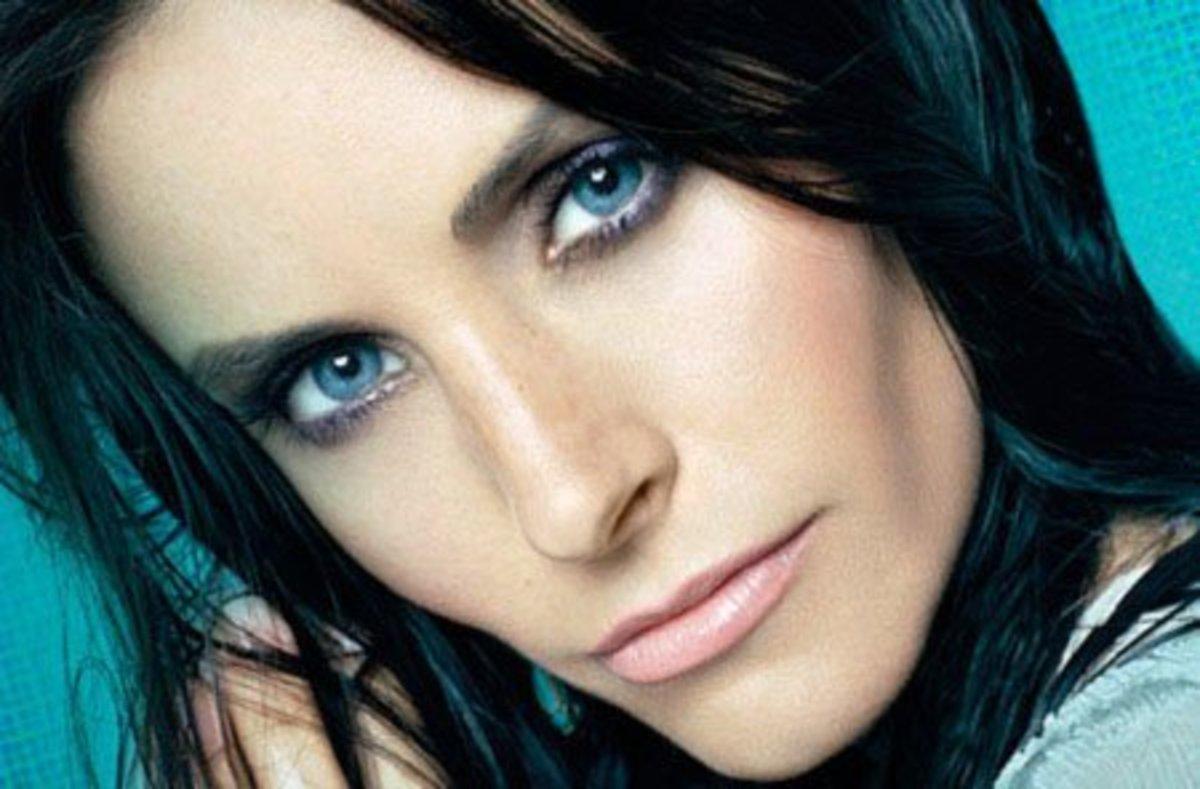 Dark hair and blue eyes