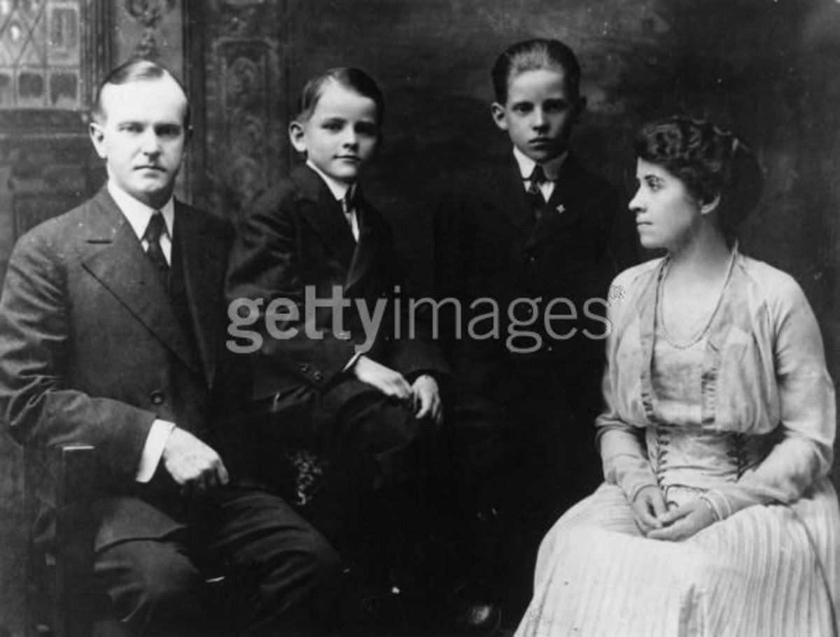 The Coolidge family in 1915; Calvin Junior is on the left, seated with his father.