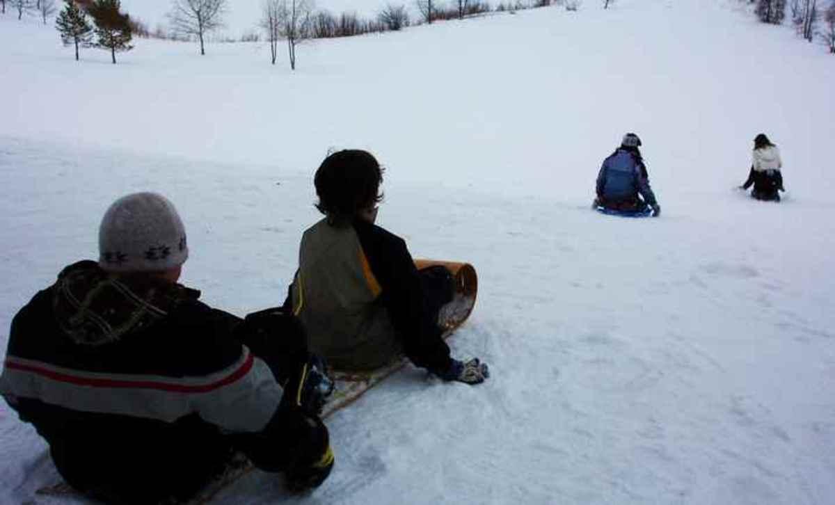 Tobogganing down a snowy hillside
