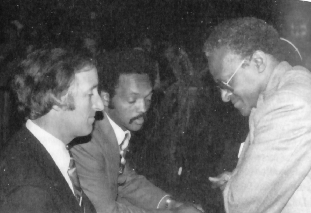 "Bernard Spong (left) and Bishop Tutu (right) talking with Jesse Jackson at the SACC offices, 1979. Photo from Bernard's book ""Sticking Around""."
