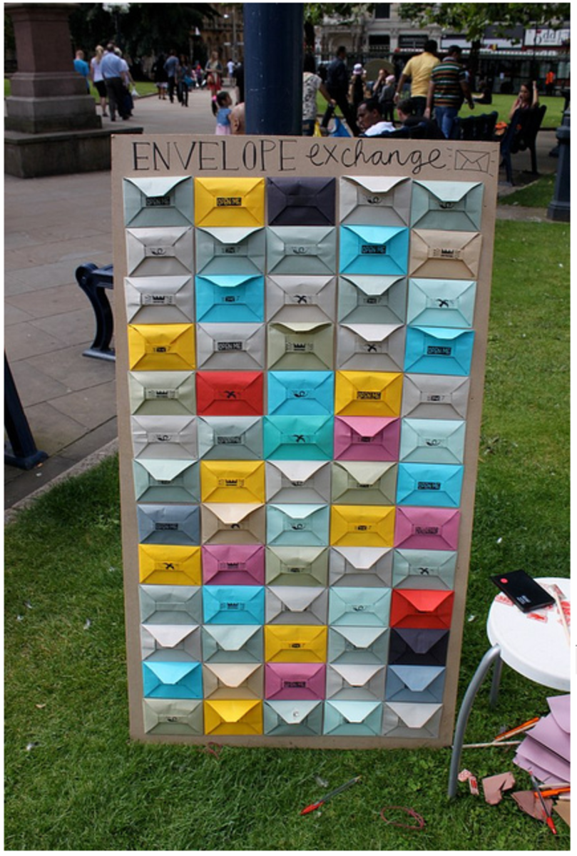 In each of these envelopes is a lovely message for you to take away with you to brighten up your day - and all you have to do in exchange is to write a nice message for someone else to find :)